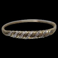 10k - .25 ct - Diamond Two Tone Swirled Ribbed Design Hinged Bangle in Yellow Gold