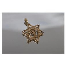 14k - .10 ct - Diamond Wooden Designed Star of David Featuring Menorah in Center Pendant Charm in Yellow Gold