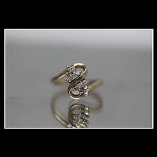 14k - .27 ctw - Diamond S Shape Bypass Ring in Yellow Gold