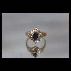 14k - .60 ctw - Diamond Accented Blue Sapphire in Infinity Bypass Ring in Yellow Gold