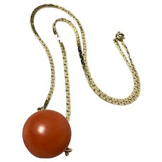 Gold necklace with large natural coral bead