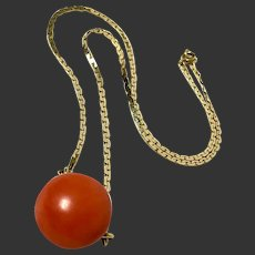 Art deco gold necklace with large natural coral bead