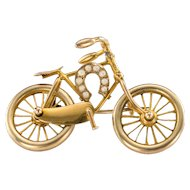 A Charming and Movable Victorian Bicycle Brooch