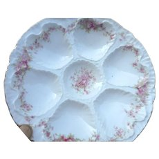 Circa 1900 porcelain 8 1/2 inch 6 well otster plate floral design