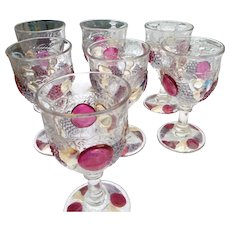 Eight vintage Westmoreland  stemmed glasses 6 inches tall in della robia pattern
