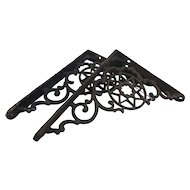 Circ 1890 pair of wrought iron decorative shelf hingesa