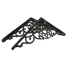 Circ 1890 pair of wrought iron decorative shelf hingesa