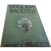 1914 edition of BrickKing backstop young men reading about baseball
