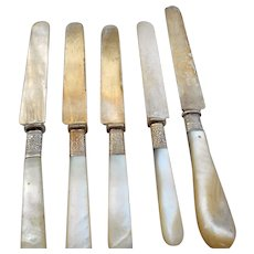 Five vintage pearl handled knives table