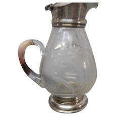 Victorian silverplate engraved crystal  syrup pitcher with flip top  and applied handle