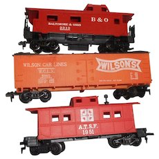 Three different Tyco h o railroad ars