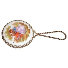 Circa 1900 ladies small purse size mirror with Limoges painted on it