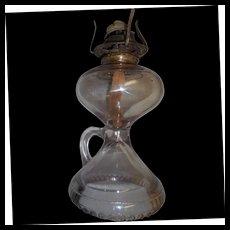 Circa 1890 finger held oil  lamp   engraved bottom rim