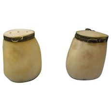 A pair of vintage mother of pearl salt and pepper shaker