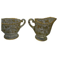 Pair of vintage elegant  glass hand painted gold floral creamer and sugar