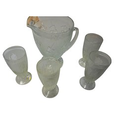 Depression glass by Jeanette iris herring bone pitcher and 4 glasses