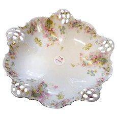 Circa 1900 porcelain three toed floral design bowl from Germany