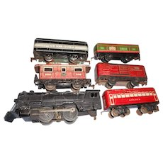 Six Vintage circa 1950 marx colored tin train cars