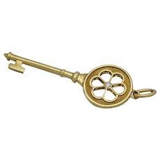 Beautiful Tiffany & Co. Yellow Gold 18k Blossom Flower Key Pendant with Diamond Center
