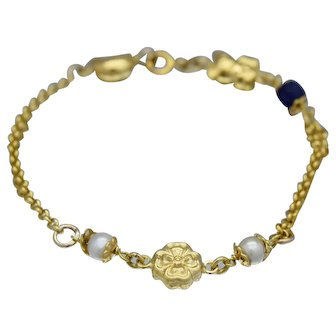 18k Yellow Gold lapis lazuli and Pearls Charm Bracelet