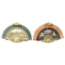 Pair of Italian fans in carved and gilded wood from 20th century