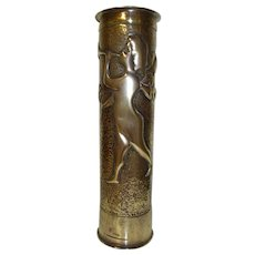 French Trench Art, Gun Shell Case. Repoussé Cherub Holding a daisy and playing the Trumpet Trench Art