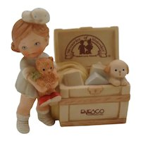 Enesco Girl with Trunk The Memories Of Yesterday Collection By Mabel Lucille Atwell
