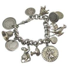 Sterling Silver Charm Bracelet 12 Charms Toadstool Bee Hive Monkey Vintage c1970