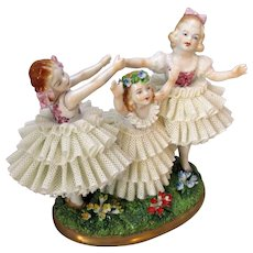 Vintage Sitzendorf Dresden Style Lace Figurine 'Three Children on Moss'.