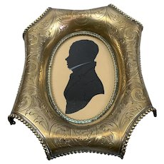 Coloured Silhouette With Highlights In a Gilded Brass Curly Frame Victorian c1840