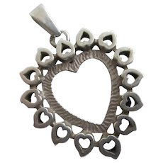 Pierced Heart Sterling Silver Pendant Vintage c1980.
