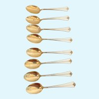 8 David Anderson Sterling and White Enamel teaspoons.