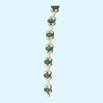 Los Ballesteros bracelet, silver carved carved green stone faces