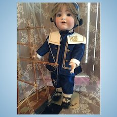 Lovely Franz Schmidt doll in a gorgeous sailor costume, special mold number 1295.
