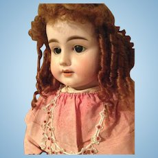 Gorgeous antique German doll with a gorgeous antique dress with gold wire.
