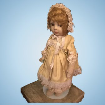Lovely Lenci doll with a Dutch wooden chair