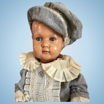 Lovely boy doll with an open closed mouth with lovely blue glass eyes - ca. 1900