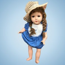 Lovely celluloid doll with a mama voice together with a lovely stroller