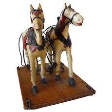 Two American 19th Century Carved Painted Horses Pull Toy
