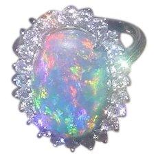 Gorgeous Australian Lightening Ridge Black Opal 8.98 Carat, Set In 14K White Gold w/ 1.2 Carats of Diamonds.