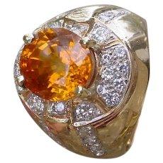5 Carat Oval Orange Sapphire In 18K Gold Ring w/ Diamonds.