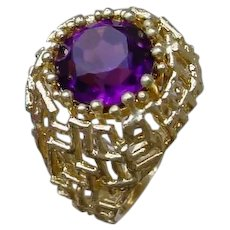 Interesting 18K Gold Ring w/ Synthetic Purple Stone.