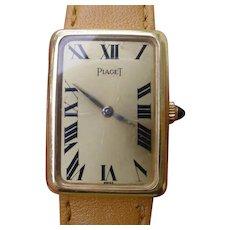 Ladies Piaget 18K Gold Rectangular Case, Large Roman Numerals Dial, Mechanical Wind Movement.