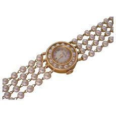 Beautiful Ladies Lucien Piccard Watch in 14K Gold And 88 Pearls Bracelet.