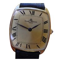 Baume & Mercier 18K Gold Gents Watch, Large Roman Numerals.