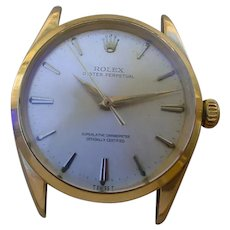 Rolex Oyster Perpetual 1002 14K Gold.