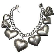 Sterling Puffy Heart Charm Bracelet- 8 Hearts