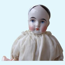 Uncommon  Pierced Ears China Doll