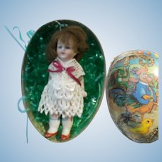 All Bisque Glass Eyed Doll in an Egg