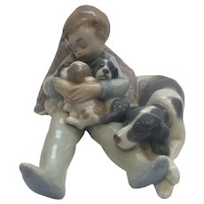 Lladro Boy with Puppies